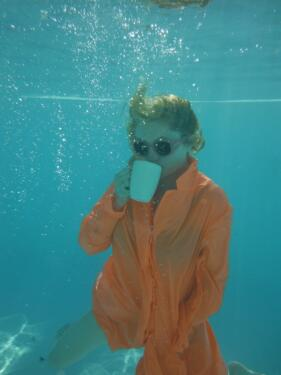 Alison Goldfrapp drinks tea underwater. Copyright, Alison Goldfrapp.
